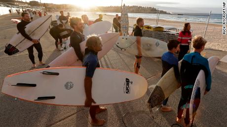 Surfers are waiting for officials to open Bondi Beach in Sydney on April 28 because the coronavirus pandemic restrictions are eased. This beach is open for swimmers and surfers to exercise alone.
