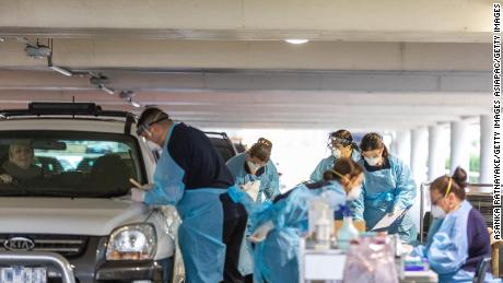 Medical practitioners conducted a test for Covid-19 at a drive-thru testing facility in a parking lot on April 30 in Melbourne, Australia.