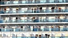 People waved when the Ruby Princess cruise ship departed from Port Kembla, about 80 kilometers south of Sydney, on April 23, after several hundred virus-free crew members descended to begin the repatriation process to their home country.