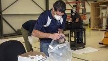 Engineer Mike Buttigieg from NASA works at the Aerospace Valley Positive Pressure Helmet.
