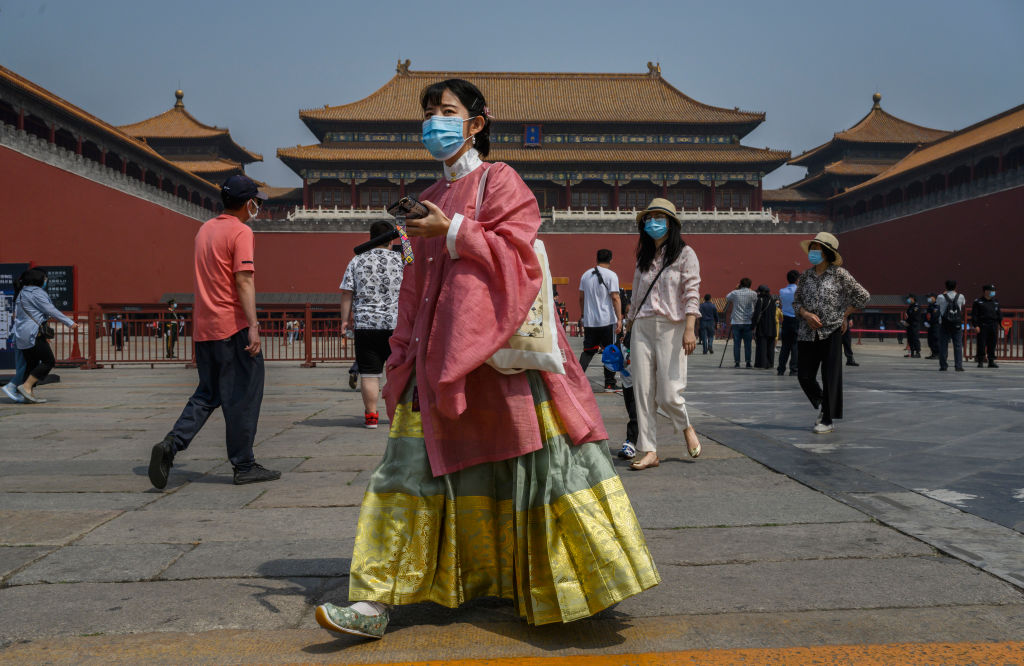 A Chinese tourist wears a mask in the Forbidden City of Beijing on May 1.