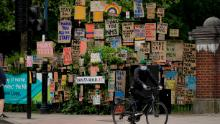 Signs supporting the National Health Service have been displayed by an artist in east London. (Matt Dunham / AP)