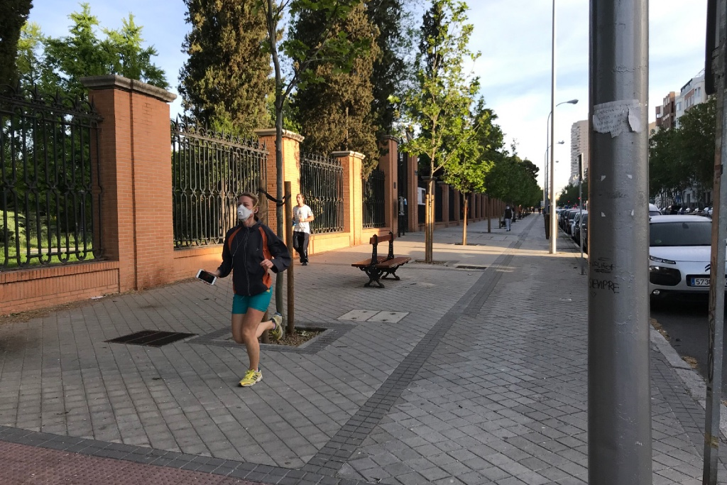 Some runners and cyclists wear masks when they are allowed out for solo training in their city.