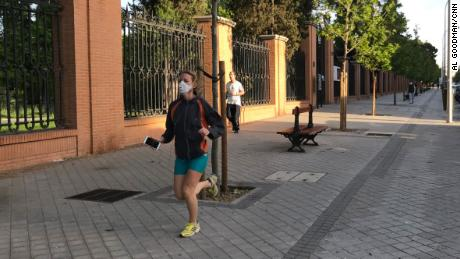 Some runners and cyclists wear masks when Spaniards are allowed out to exercise for the first time in seven weeks.
