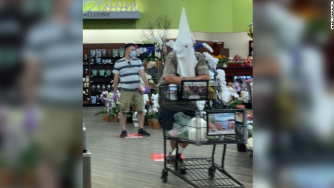 Man wears what appears to be KKK white hood to supermarket