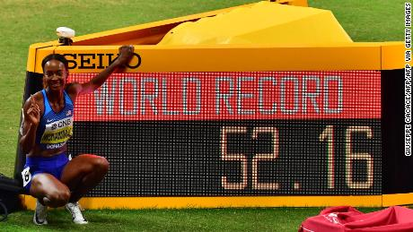 Muhammad posed beside the screen while reading the new world record he set in the Women's 400m hurdles at the 2019 IAAF Athletics World Championships at the Khalifa International stadium.