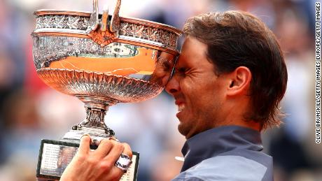 Rafael Nadal lifted the French Open trophy for the 12th time after a four-set victory over Dominic Thiem in Paris.