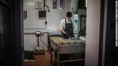 A cook works in Barcelona, Spain on April 16 after his restaurant kitchen is converted to prepare food for health workers and vulnerable people.