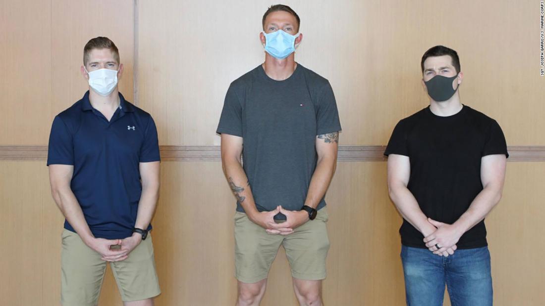 Marine Corps Capt. Daniel Kult, left, Sgt. John Dietrick, center, and Pfc. Alexander Meinhardt restrained a passenger on a flight from Tokyo.