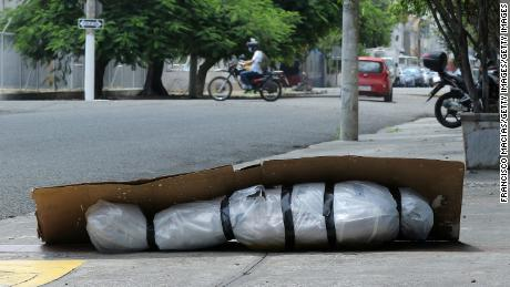 The corpse left behind was wrapped in plastic and covered with cardboard located on a sidewalk in Guayaquil, Ecuador, on April 6.