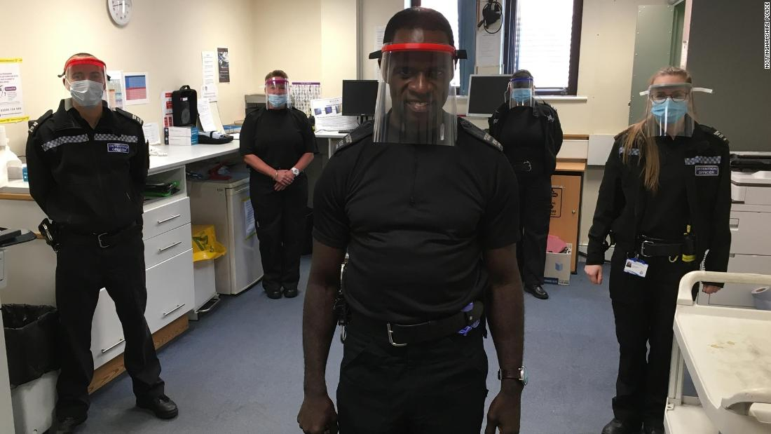 Officers wear the face visors that were donated.