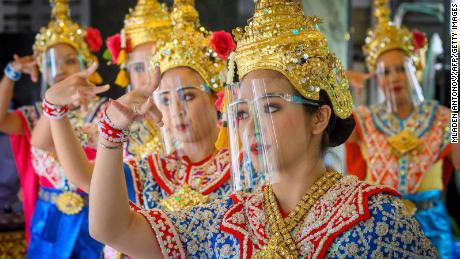 Traditional Thai dancers perform at the Bangkok temple which reopened last week.