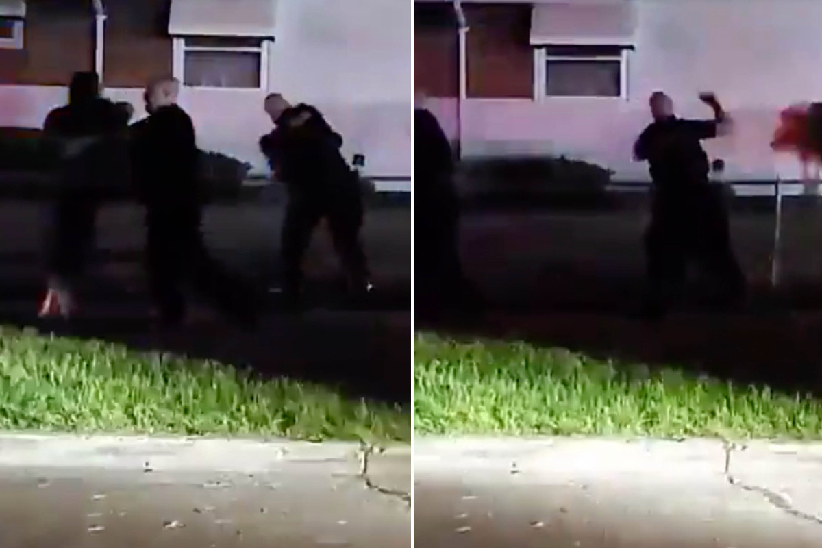 White Michigan police caught on camera as they stabbed a black woman