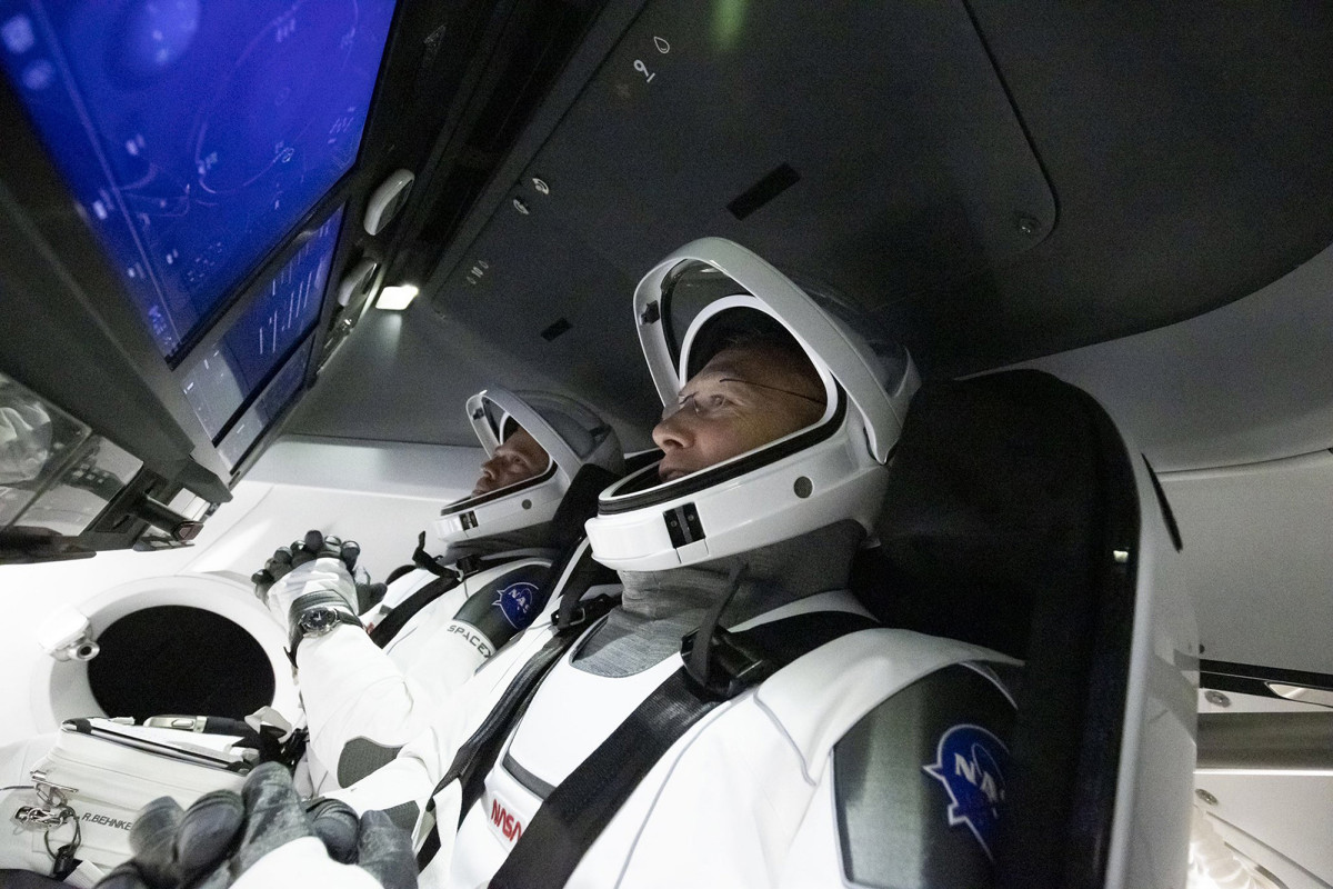 NASA astronauts return to spaceX capsule for historical launch