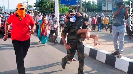 Rescuers evacuated people after the gas leak incident at the LG Polymers factory in Visakhapatnam on May 7.