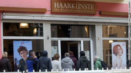 The line forms at the salon in Berlin on Monday after the hairdresser is allowed to reopen.