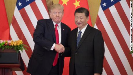 US President Donald Trump (left) shakes hands with Chinese President Xi Jinping during a press conference at the Great Hall of the People in Beijing on November 9, 2017.