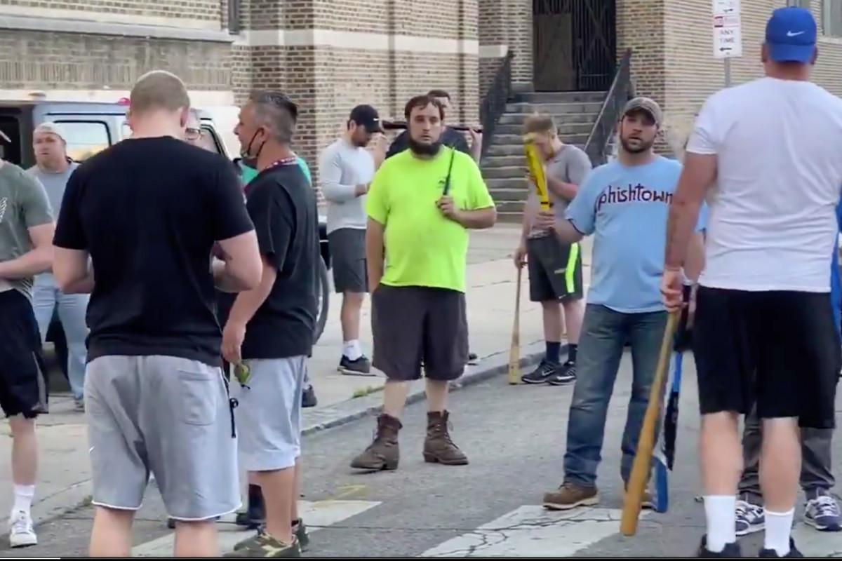Protesters and vigilantes face the Philadelphia neighborhood