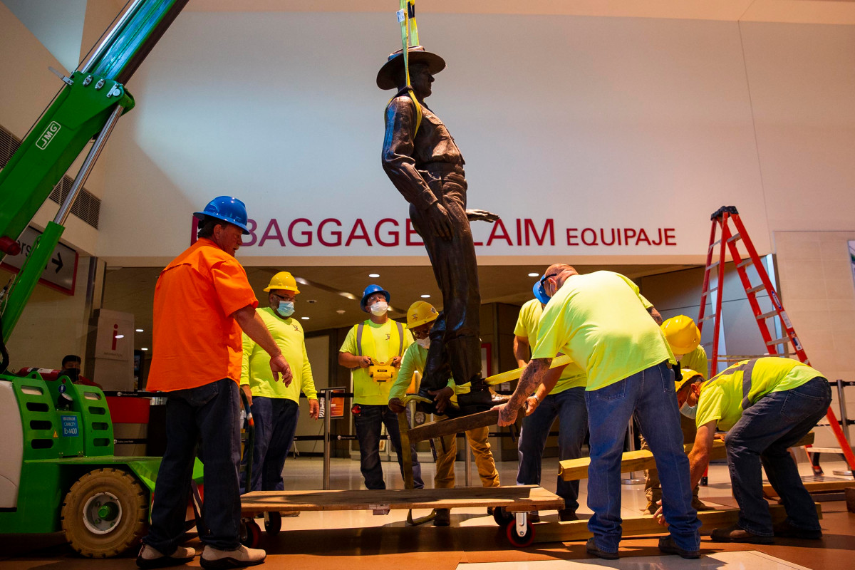 A Texas Ranger statue has been removed from Dallas Love Field Airport