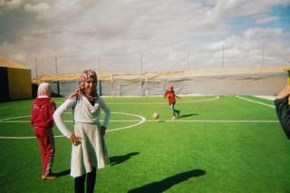 Girls train on a football pitch