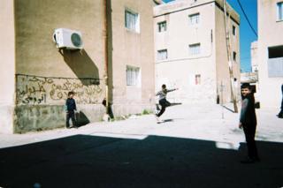 Children play football outdoors