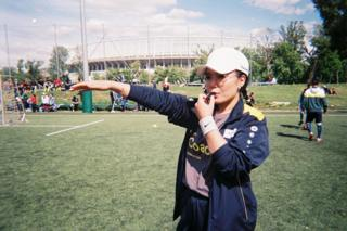 A coach poses for the camera