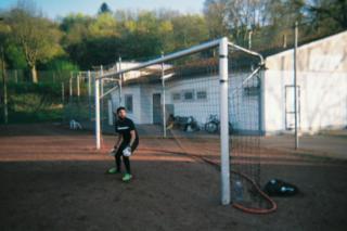 A goalkeeper stands in a goal
