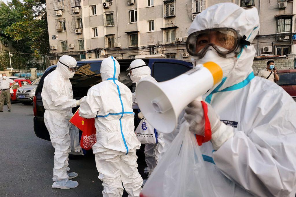 Beijing reports over 100 new coronavirus cases, expands lockdown