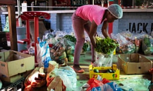 A member of staff packs food hampers for people in need at the Railways cafe, Pretoria, South Africa, on 4 June 2020. The cafe has begun feeding the homeless in the area as the coronavirus lockdown has forced thousands of homeless and less fortunate into begging for food.