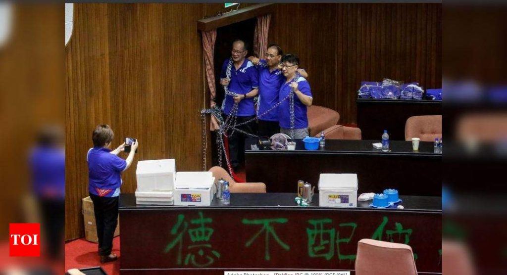 Fighting in Taiwan parliament after opposition occupies building