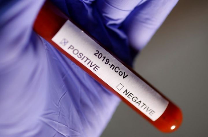 © Reuters. FILE PHOTO: Test tube with Corona virus name label is seen in this illustration picture