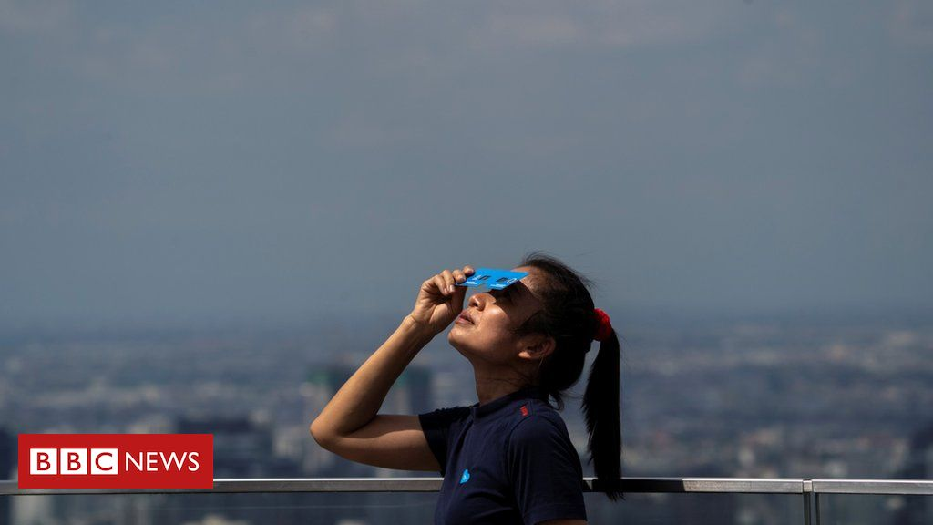 In pictures: Rare solar eclipse darkens Asia on the summer solstice