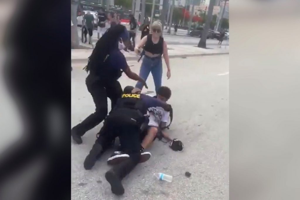 Miami protesters smashing cop car with skateboards: video