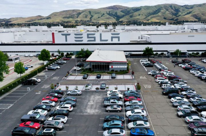 Tesla tells employees merit awards are on hold after Covid-19