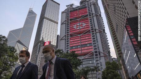 Pedestrians walking past HSBC's Hong Kong headquarters in April.