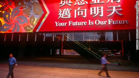 A large banner hanging over the entrance of HSBC on June 30, 1997, the day before the handover from Britain to China in Hong Kong.