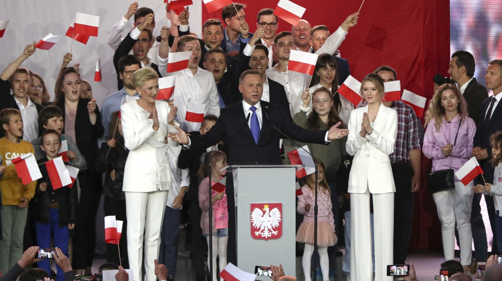 Incumbent President Andrzej Duda, center, gestures next to his wife Agata Kornhauser-Duda and daughter Kinga, right while speaking to supporters in Pultusk, Poland, Sunday, July 12, 2020. Conservative