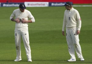 Root watches teammate Stokes holding his stomach.
