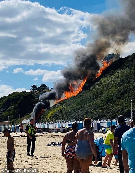 Emergency services have scrambled to the West Undercliff area, where a cordon has been erected and sun-bathers evacuated. The fire quickly spread from the burning beach huts and has blazed a path of destruction up 100sqm of heath where photos show it is perilously close to the cliff-top hotel and other homes.