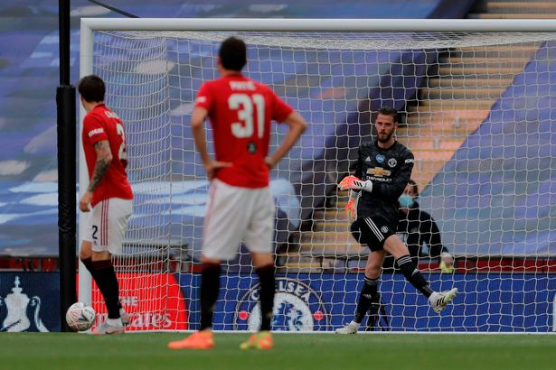 The United keeper kicks the ball away after Chelsea doubled their lead