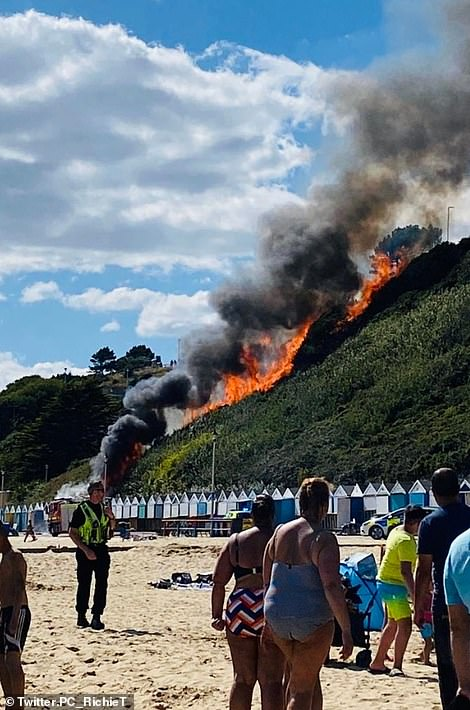 The blaze rips up the side of the hill yesterday afternoon