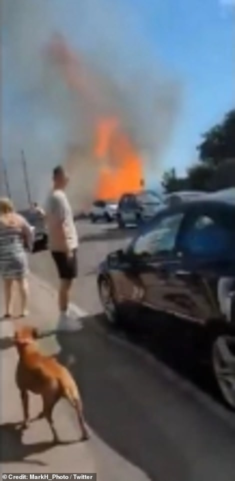 In the video taken close to the evacuated Highcliff Marriott hotel, a car hastily reverses away from the roadside where thick smoke and huge flames were thrown up by the sea breeze on Monday afternoon