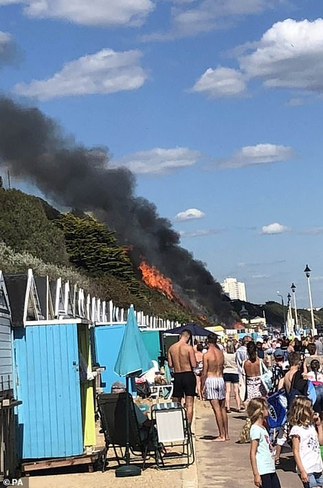 Emergency services scrambled to the West Undercliff area, where a cordon was erected and sun-bathers were evacuated. The fire quickly spread from the burning beach huts and has blazed a path of destruction up 100sqm of heath where photos show it is perilously close to the cliff-top hotel and other homes