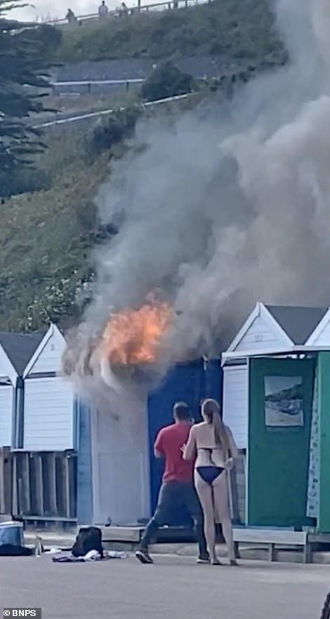 The hut burning