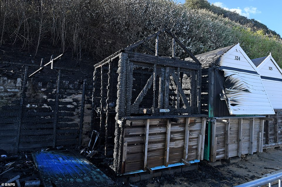 Other beach huts were destroyed and badly damaged by the fire which raged up the gorse-covered cliff face on Monday afternoon