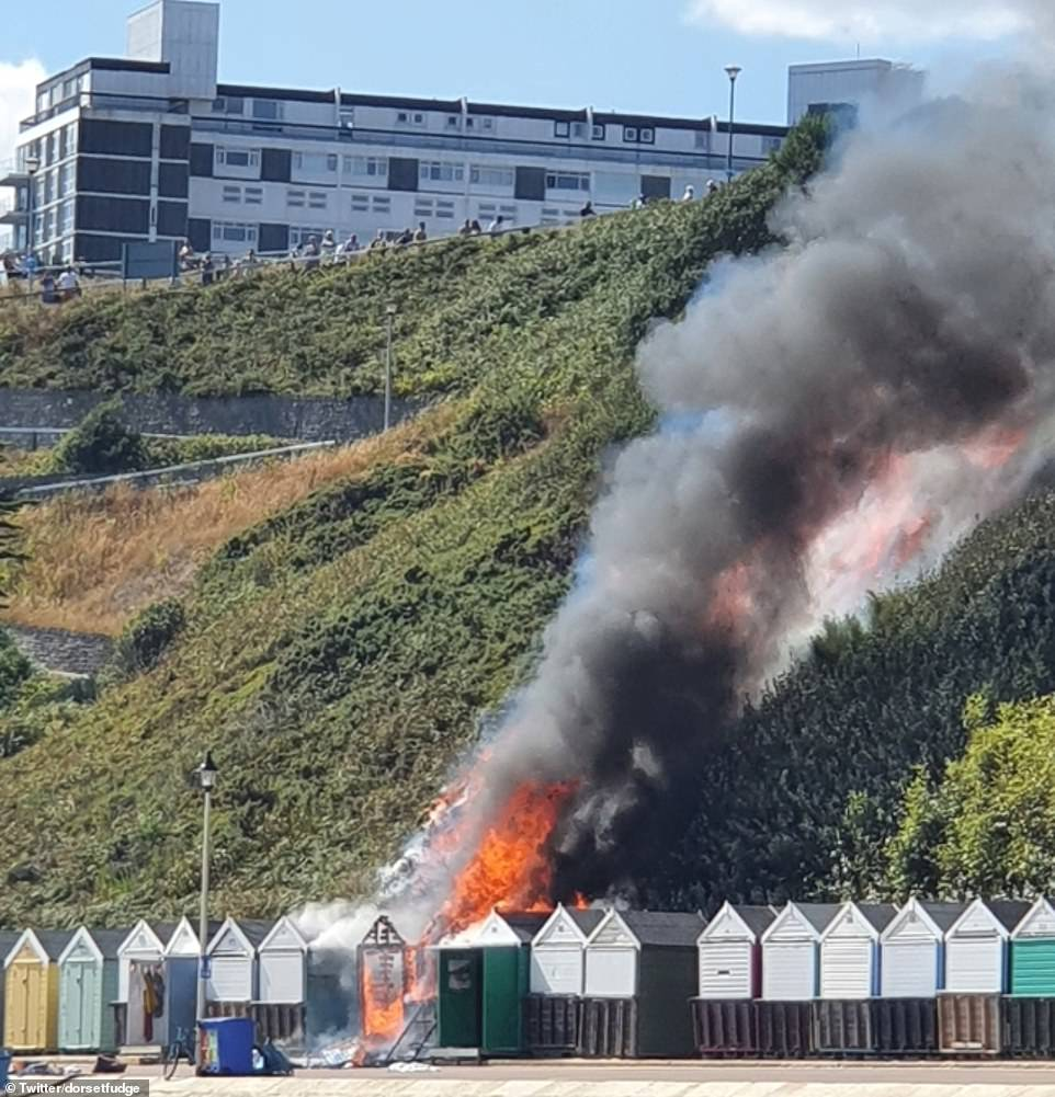 Unconfirmed reports suggest the fire was sparked by one of the burning beach huts before quickly engulfing 100sqm of heath