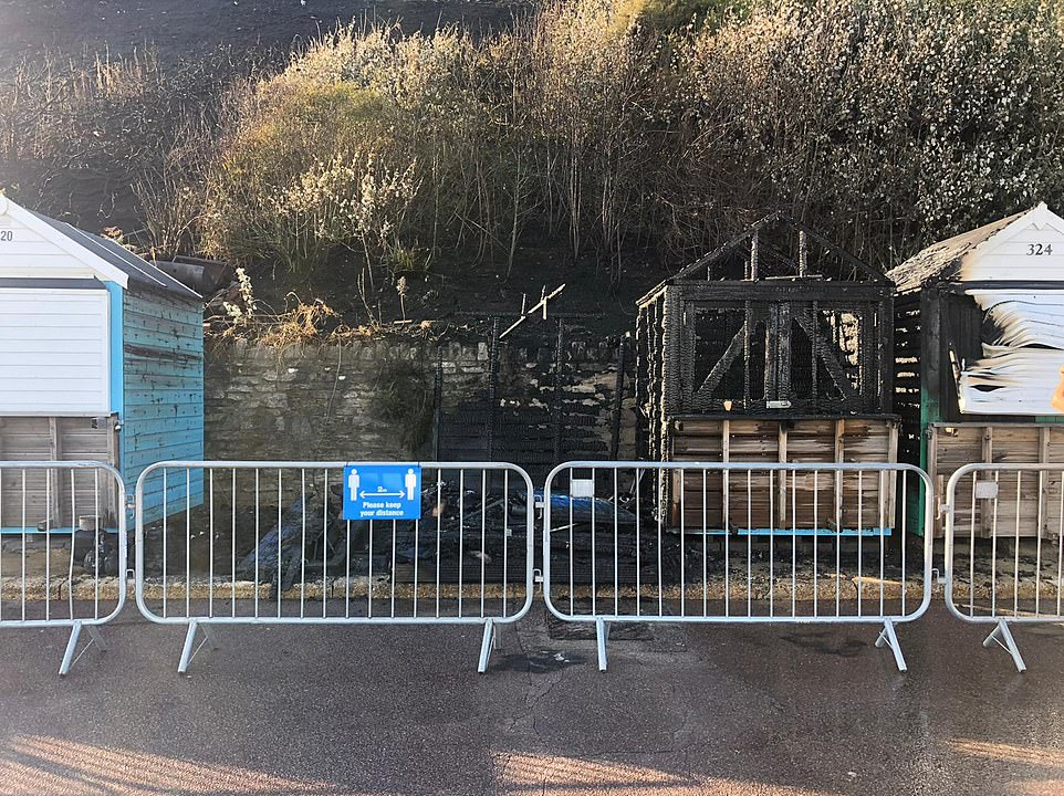 The fire appears to have totally destroyed at least two beach huts, with others left severely damaged by the blaze with was started by a gas stove