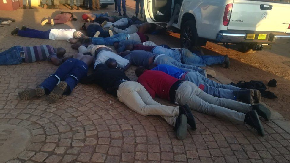 Police released images of suspects lying on the ground