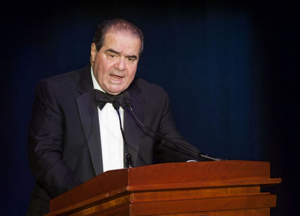 """FILE - In this Nov. 6, 2014, file photo Supreme Court Justice Antonin Scalia speaks in Washington. President Donald Trump has visions of establishing by the final months of his second term—should he win one—a """"National Garden of American Heroes"""" that will pay tribute to some of the prominent figures in the nation's history, including Justice Scalia, that he sees as the """"greatest Americans to ever live."""" The president unveiled his plan Friday, July 3, 2020, during his speech at Mount Rushmore National Memorial, S.D. (AP Photo/Kevin Wolf, File)"""