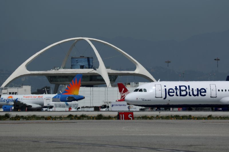 © Reuters. A Jet Blue airplane is seen at Los Angeles International airport